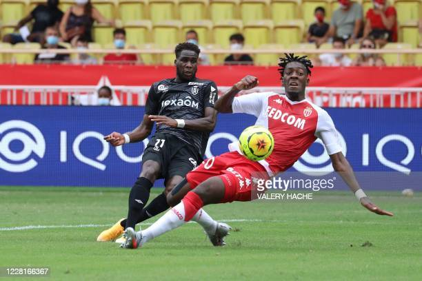 Reims' French forward Boulaye Dia vies with Monaco's French defender Axel Disasi during the French L1 football match between AS Monaco and Stade de...
