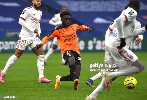 Reims' French forward Nathanael Mbuku kicks the ball during the French L1 football match between Lyon and Reims on November 29 2020 at the Groupama...