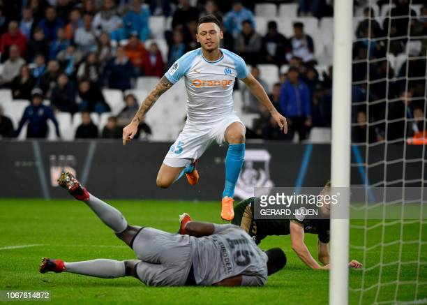 Reims' French goalkeeper Edouard Mendy catches the ball kicked by Marseille's Argentine midfielder Lucas Ocampos during the French L1 football match...