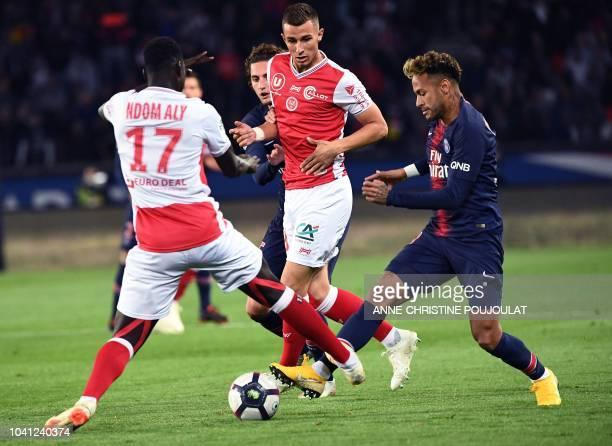 Reims' French midfielder Aly Ndom vies with Paris SaintGermain's Brazilian forward Neymar during the French L1 football match between Paris Saint...