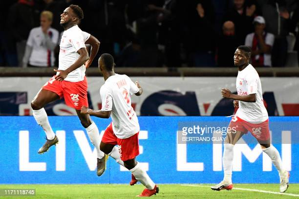 Reims' French midfielder Boulaye Dia celebrates their second goal during the French L1 football match between Paris Saint-Germain and Stade de Reims...