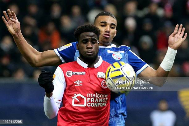 Reims' French midfielder Boulaye Dia vies with Strasbourg's French defender Alexander Djiku during the French League Cup quarterfinal football match...