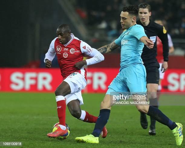 Reims' French midfielder Hassane Kamara vies with Marseille's Argentine midfielder Lucas Ocampos during the French L1 football match between Stade de...