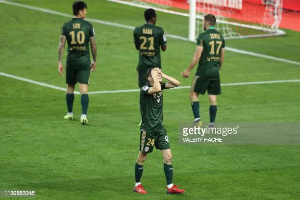 Reims' French Midfielder Mathieu Cafaro reacts at the end of the French L1 football match between Monaco and Stade de Reims on April 13, 2019 at the...