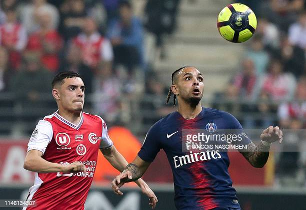 Reims' French Midfielder Mathieu Cafaro vies with Paris' defender Layvin Kurzawa during the French Ligue 1 football match between Reims and Paris...