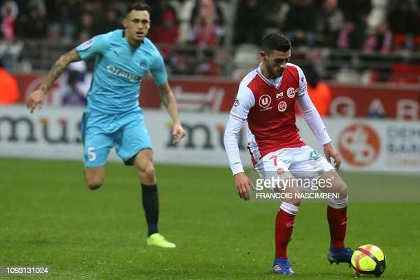 Reims' French midfielder Xavier Chavalerin vies with Marseille's Argentine midfielder Lucas Ocampos during the French L1 football match between Stade...