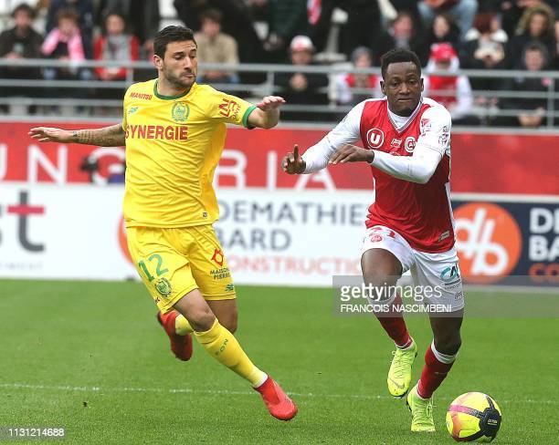 Reims' Ghanaian defender Abdul Rahman Baba fights for the ball with Nantes' Brazilian midfielder Gabriel Boschilia during the French L1 football...