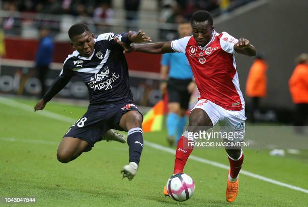 Reims' Ivoirian defender Ghislain Konan vies with Bordeaux' midfielder Zaydou Youssouf during the French L1 football match between Reims and Bordeaux...