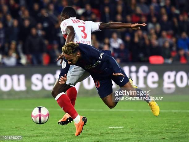Reims' Ivorian defender Ghislain Konan vies with Paris SaintGermain's Brazilian forward Neymar during the French L1 football match between Paris...