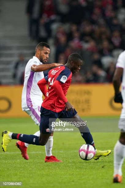 Reims' JacquesAlaixys Romao fights for the ball with Lille's Nicolas Pepe during Ligue 1 match between Lille OSC and Stade de Reims at Stade Pierre...