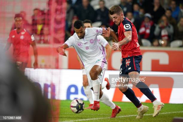 Reims' JacquesAlaixys Romao fights for the ball with Lille's Xeka during Ligue 1 match between Lille OSC and Stade de Reims at Stade Pierre Mauroy on...