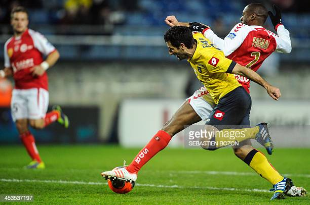 Reims' Malian defender Mohamed Fofana challenges Sochaux's French forward Pierre Alain Frau during the French L1 football match between Sochaux and...