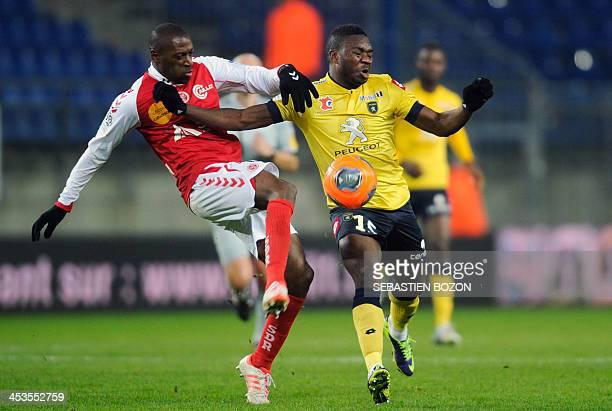 Reims' Malian defender Mohamed Fofana challenges Sochaux's Zambian forward Emmanuel Mayuka during the French L1 football match between Sochaux and...