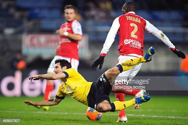 Reims' Malian defender Mohamed Fofana fouls Sochaux's French forward Pierre Alain Frau during the French L1 football match between Sochaux and Reims...