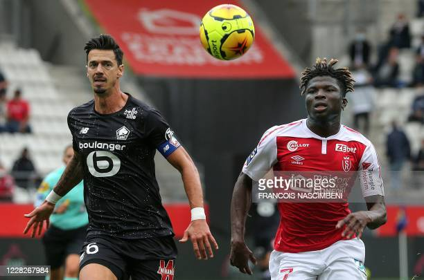 Reims' Malian forward El Bilal Toure vies with Lille's Portuguese defender Jose Da Rocha Fonte during the French L1 football match between Reims and...