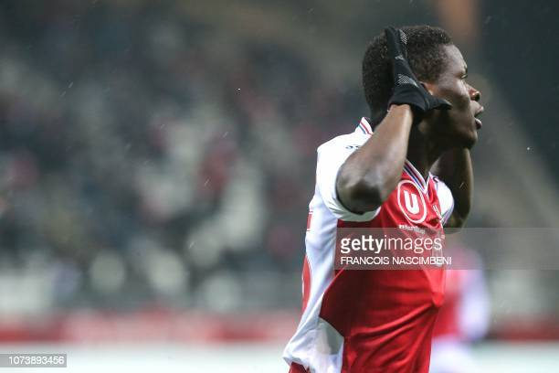 Reims' Malian midfielder Moussa Doumbia celebrates after scoring during the French L1 football match between Stade de Reims and Racing Club...