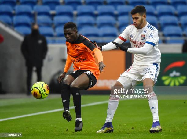 Reims' Malian midfielder Moussa Doumbia fights for the ball with Lyon's Brazilian midfielder Bruno Soares during the French L1 football match between...
