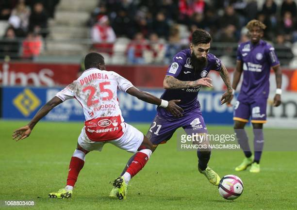 Reims' Malian midfielder Moussa Doumbia vies for the ball with Toulouse's Swedish midfielder Jimmy Durmaz during the French L1 football match between...