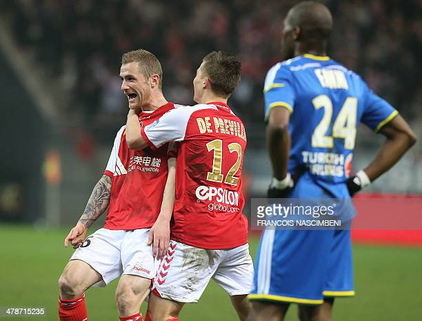 Reims' midfielder Antoine Devaux jubilates with teammate forward Nicolas de Préville after scoring a goal during the French L1 football match Reims...