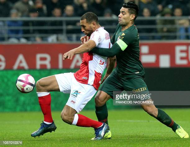 Reims' Moroccan defender Yunis Abdelhamid vies for the ball with Monaco's Colombian forward Falcao during the French L1 football match between Stade...