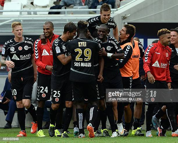 Reims' players celebrate after scoring a goal during the French L1 football match between Bordeaux and Reims at the new Stade in Bordeaux...