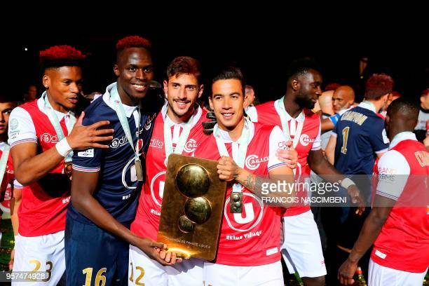 Reims players celebrate with their trophy after winning the French L2 championship at the end of the football match betweens Reims and Nimes on May...