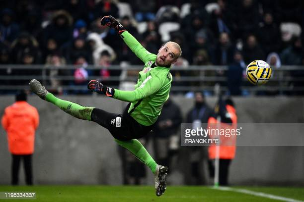 Reims' Serbian goalkeeper Predrag Rajkovic jumps for the ball during the French League Cup semifinal football match between Stade de Reims and Paris...