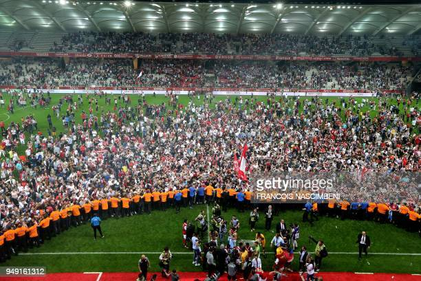 TOPSHOT Reims' supporters celebrate after Stade de Reims won and got promoted to the Ligue 1 after the Ligue 2 Football match ReimsAjaccio on April...