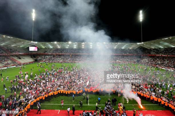 Reims' supporters celebrate after Stade de Reims won and got promoted to the Ligue 1 after the Ligue 2 Football match ReimsAjaccio on April 20 2018...