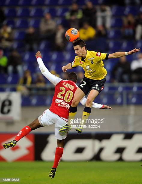 Reims' Togolese forward Floyd Ayite challenges Sochaux's French defender Sebastien Corchia as he jumps to head the ball during the French L1 football...