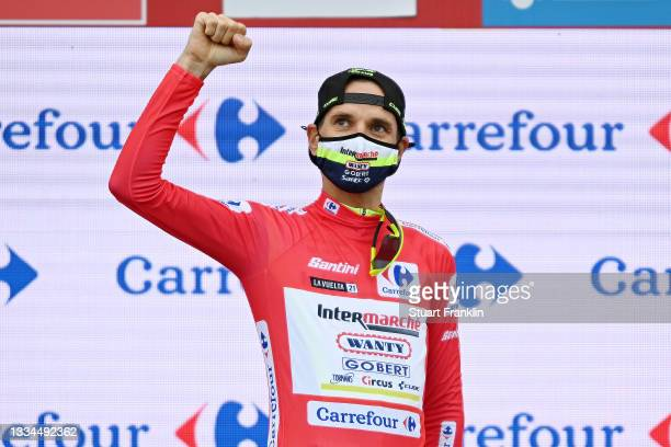 Rein Taaramäe of Estonia and Team Intermarché - Wanty - Gobert Matériaux celebrates winning the red leader jersey on the podium ceremony after the...