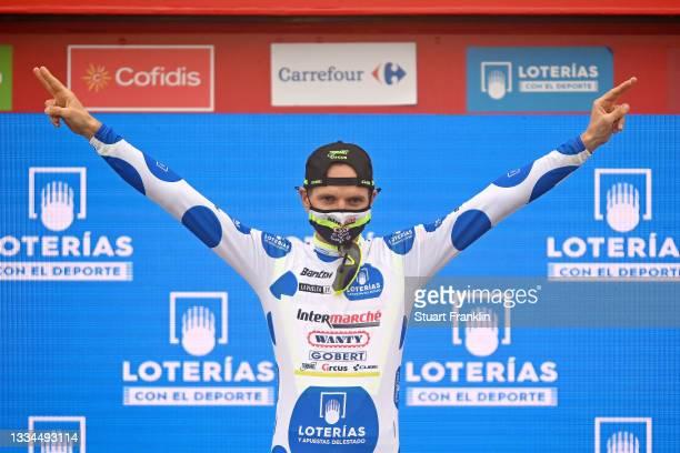 Rein Taaramäe of Estonia and Team Intermarché - Wanty - Gobert Matériaux celebrates winning the polka dot mountain jersey on the podium ceremony...