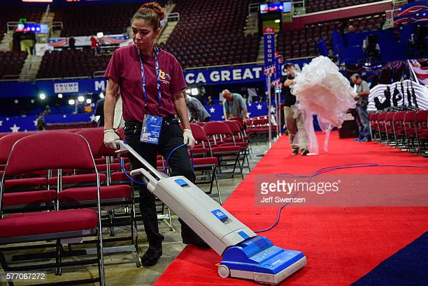 Reina Checo an employee of the Quicken Loans Arena vacuums the floor of the Republican National Convention in final preparations on the morning of...