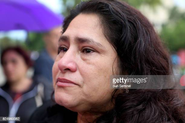 Reina Gomez an undocumented Honduran woman battling a rare form of leukemia cries as she speaks to the media before her scheduled checkin appointment...