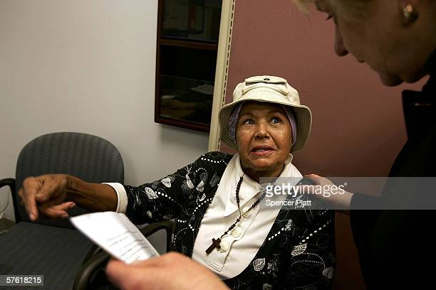 Reina Gomez speaks with a Medicare consultant on the last day for enrollment in the Medicare Part D program May 15, 2006 in New York City. According...