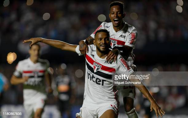 Reinaldo of Sao Paulo celebrates his team first goal with a teammate player Tche Tche during a match between Sao Paulo and Corinthians for the...