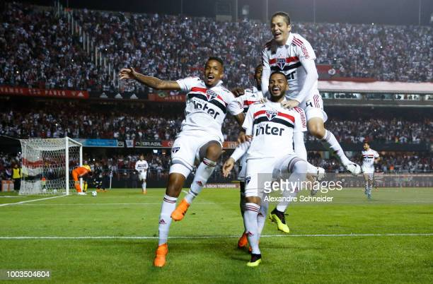 Reinaldo of Sao Paulo celebrates with his teammates after scoring his team's third goal during the match between Sao Paulo and Corinthians for the...