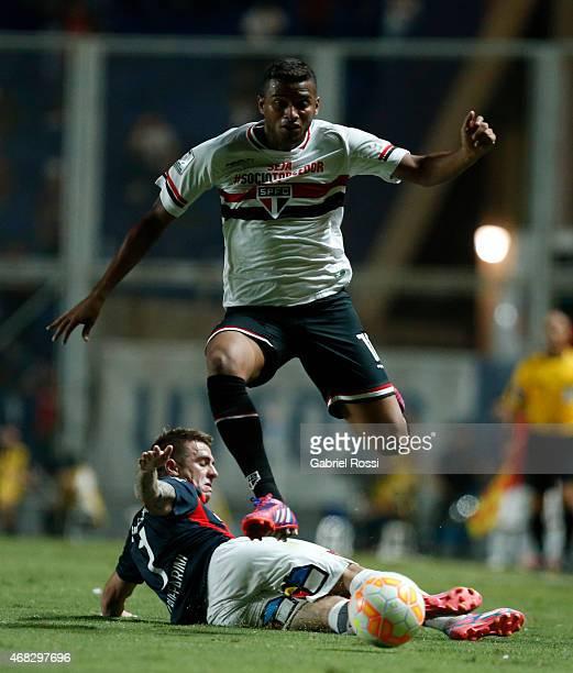 Reinaldo of Sao Paulo fights for the ball with Julio Buffarini of San Lorenzo during a match between San Lorenzo and Sao Paulo as part of Copa...