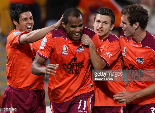 Reinaldo of the Roar celebrates with team mates after scoring a goal during the round 10 A-League match between the Brisbane Roar and the Newcastle...
