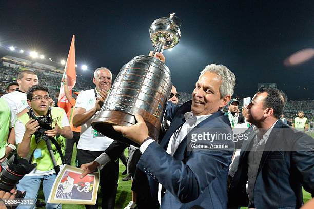 Reinaldo Rueda coach of Atletico Nacional lifts the trophy after a second leg final match between Atletico Nacional and Independiente del Valle as...