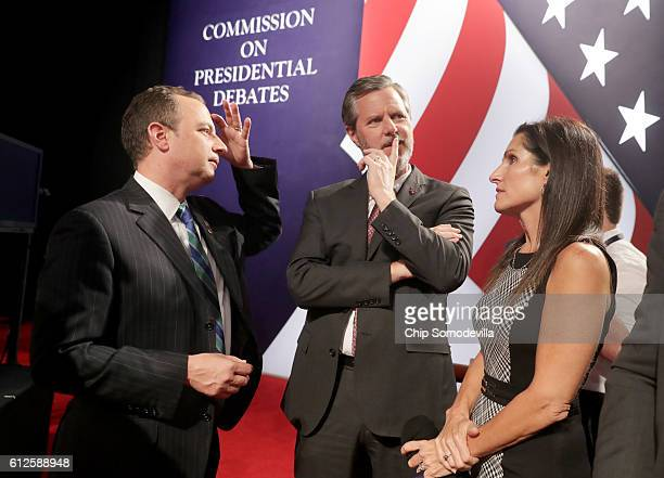 Reince Priebus chairman of the Republican National Committee Jerry Falwell Jr and Becky Tilley speak prior to the Vice Presidential Debate between...