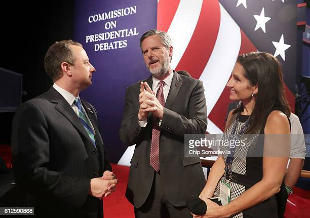 Reince Priebus chairman of the Republican National Committee Jerry Falwell Jr and Becky Tilley talk prior to the Vice Presidential Debate between...