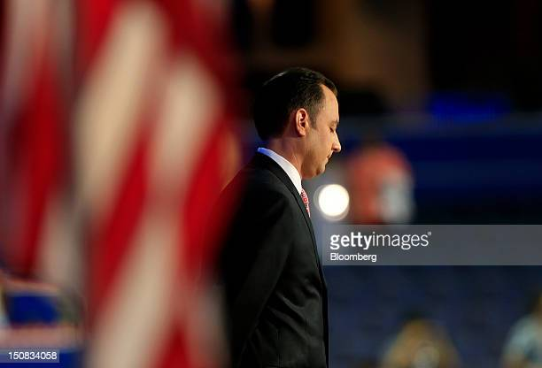 Reince Priebus chairman of the Republican National Committee listens while Reverend Dr Russell Levenson unseen speaks before banging the gavel at the...