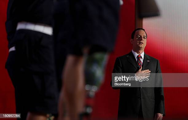 Reince Priebus chairman of the Republican National Committee recites the pledge of allegiance at the Republican National Convention in Tampa Florida...