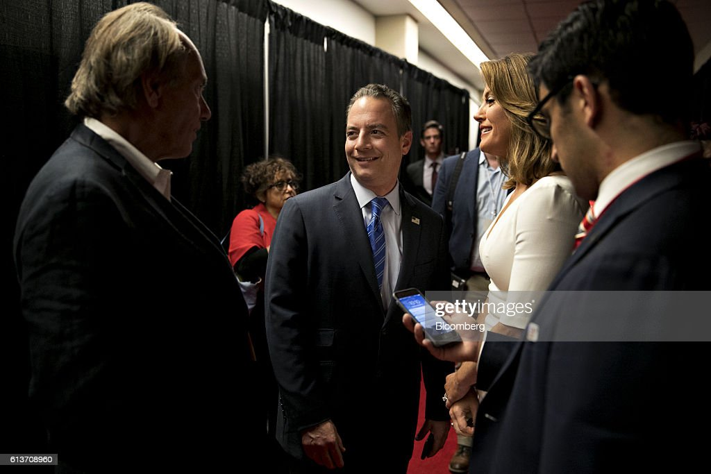Reince Priebus, chairman of the Republican National Committee, speaks with attendees after the second U.S. presidential debate at Washington University in St. Louis, Missouri, U.S., on Sunday, Oct. 9, 2016. Donald Trump and Hillary Clinton combined salacious charges about past sexual scandals with sober discussion of substantive topics during their second presidential debate Sunday night following a weekend of unprecedented crisis in the Republican nominee's campaign.. Photographer: Daniel Acker/Bloomberg via Getty Images