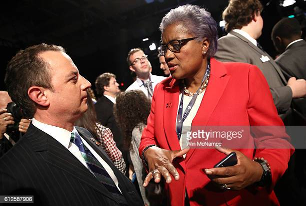 Reince Priebus chairman of the Republican National Committee talks with CNN commentator Donna Brazile prior to the Vice Presidential Debate between...