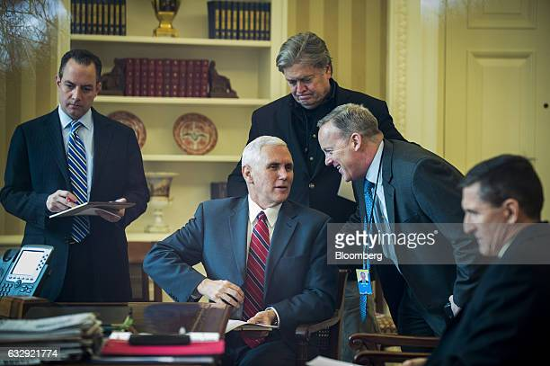 Reince Priebus White House chief of staff from left US Vice President Mike Pence Steve Bannon chief strategist for US President Donald Trump Sean...