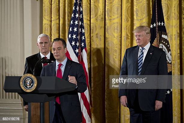 Reince Priebus White House chief of staff speaks as US President Donald Trump and US Vice President Mike Pence listen during a swearing in ceremony...