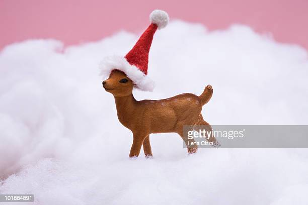 a reindeer figurine standing in fake snow - fake snow stock pictures, royalty-free photos & images