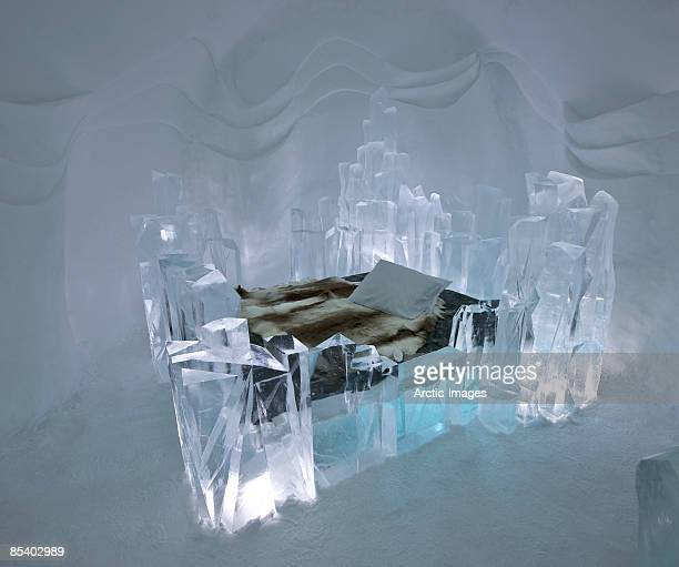 reindeer hides on bed in ice hotel - ice hotel sweden stock pictures, royalty-free photos & images